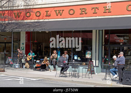 Asheville, North Carolina, USA - March 24, 2017:  Buskers play music for tips on the street in front of the historic - Stock Photo