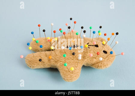 a quirky teddy bear like a voodoo doll isolated - Stock Photo