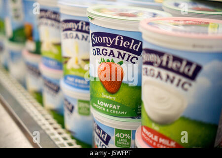 Containers of Stonyfield Farm organic yogurt in a supermarket cooler in New York on Wednesday, May 10, 2017. Yili - Stock Photo