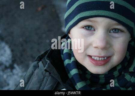 mouth teeth face portrait tricky boy lad male youngster child winter mouth cold - Stock Photo