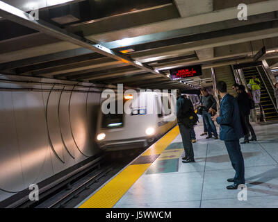 'Bart' (Bay Area Rapid Transit) train arriving underground at Market Street station San Francisco California USA - Stock Photo