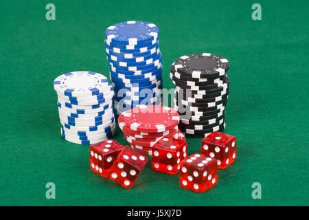 casino poker chips with wrfel - Stock Photo