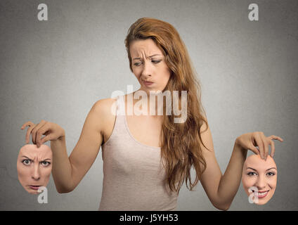 beautiful girl holds two masks - Stock Photo