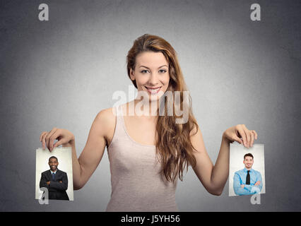 Beautiful woman undecided about which man to choose. Human emotions - Stock Photo