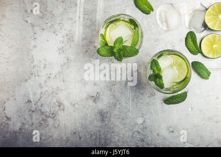 Mojito cocktail on light gray background with copy space for recipe or text viewed from above - Stock Photo