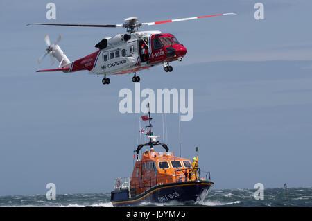 Coastguard helicopter and lifeboat - Stock Photo