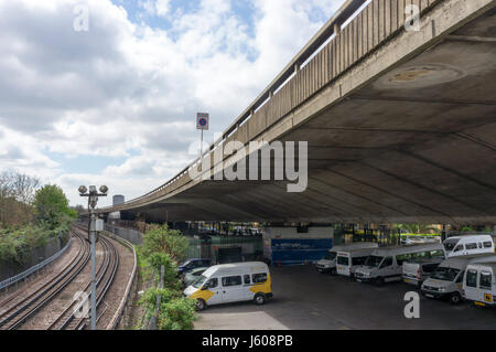 Section of the Westway near Ladbroke Grove, running next to an over ground section of the Hammersmith & City line - Stock Photo