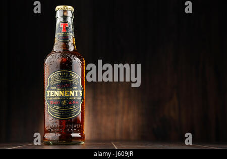 POZNAN, POLAND - AUGUST 12, 2016: Tennents Whisky Oak is a brand of beer produced by Wellpark Brewery in Glasgow - Stock Photo