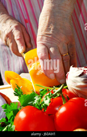 cut paprika peppers tomatoes tomatos produce vegetables fresh fabricate woman - Stock Photo