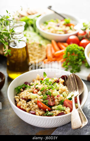 Pearl couscous salad with fresh vegetables - Stock Photo