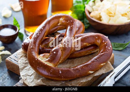 Freshly baked pretzels with beer - Stock Photo