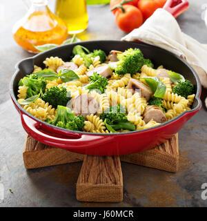 Pasta bake with sausage and broccoli - Stock Photo