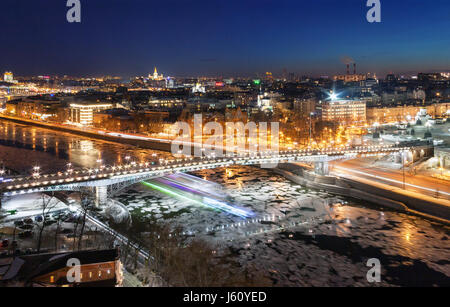 Bridge across the Moskva River with ice floes in winter. Blur from the speed boat under the bridge. Moscow, the - Stock Photo