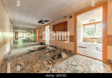 Corridor with open doors in an abandoned building of a Soviet pioneer camp - Stock Photo