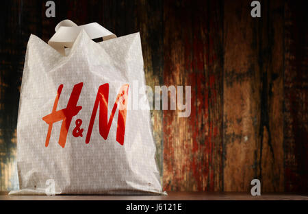 POZNAN, POLAND - NOV 25, 2016: H & M Hennes & Mauritz AB is a Swedish multinational clothing-retail company, It - Stock Photo