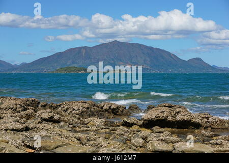 New Caledonia Grande Terre island coastal landscape with the mountain Mont Dore seen from Noumea, south Pacific, - Stock Photo