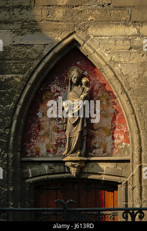 Stone sculpture of the virgin Mary and baby Jesus, detail of Saint Bavo`s cathedral in Ghent, Flanders - Stock Photo