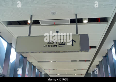 SHENZHEN, CHINA- MAY 11, 2017: Boarding sign inside of the terminal ferry, previous to board the TurboJet that provides - Stock Photo