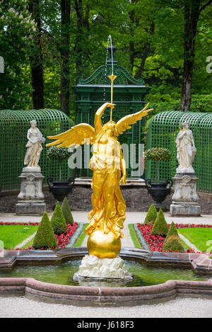 Ettal, Germany - June 5, 2016: Fountain angel in the side garden of the Linderhof Palace. Bavaria, Germany. - Stock Photo