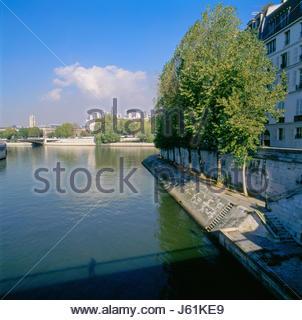 Pont St. Louis bridge, Paris France. The 'Tour St. Jacques' on the left. The Seine flowing through the small channel - Stock Photo
