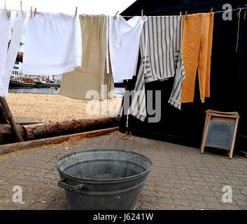 Wind; Wash Washing Dry Clothesline Laundry Bath Tub Tub Bathtub Washboard  Hanged   Stock Photo