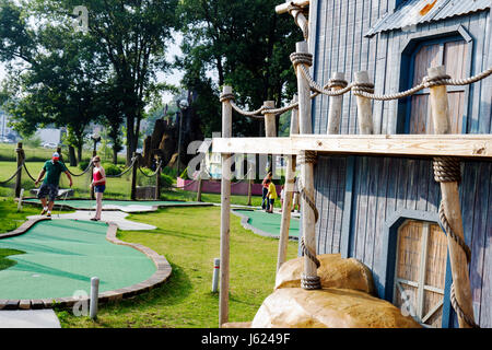 Indiana Valparaiso Zao Island Entertainment Center miniature golf fountains family entertainment man couple putting - Stock Photo