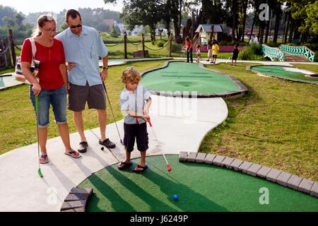 Indiana Valparaiso Zao Island Entertainment Center miniature golf fountains family entertainment man woman boy putting - Stock Photo
