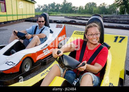 Indiana Valparaiso Zao Island Entertainment Center go kart half-scale NASCAR replica car race track drive man woman - Stock Photo