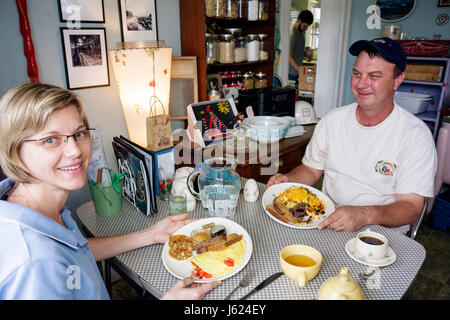 Indiana Chesterton Millwright's Daughter Cafe man woman couple table dining restaurant food omelet egg toast coffee - Stock Photo