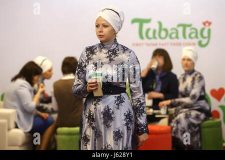 "Kazan, Russia. 19th May, 2017. A participant in the 9th International Economic Summit titled ""Russia — Islamic World: - Stock Photo"