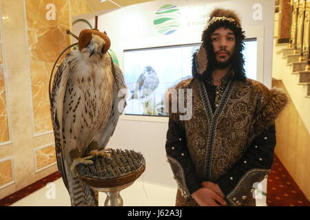 "Kazan, Russia. 19th May, 2017. A falcon and a falconer seen at the 9th International Economic Summit titled ""Russia - Stock Photo"
