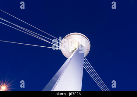The Ufo tower on the Danube Bridge by night in Bratislava - Stock Photo
