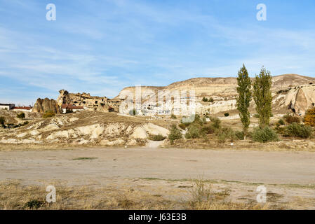 View of cave houses in rock at Cavusin. Cappadocia. Nevsehir Province. Turkey - Stock Photo