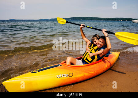 Michigan Traverse City West Arm Grand Traverse Bay Clinch Park kayak woman water sport activity recreation oars - Stock Photo