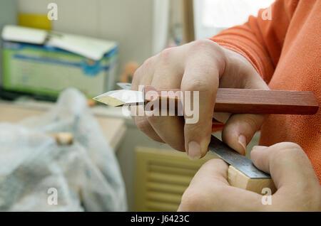 Woodworker making measurements - Stock Photo