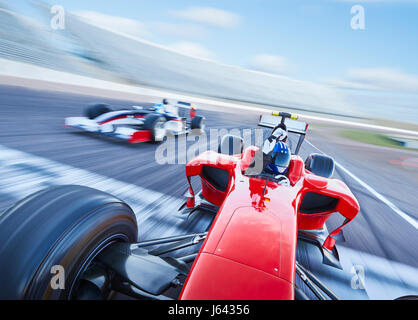 Formula one race car crossing finish line on sports track - Stock Photo