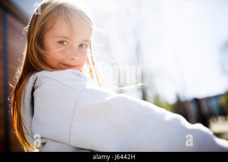 Portrait of girl at park - Stock Photo
