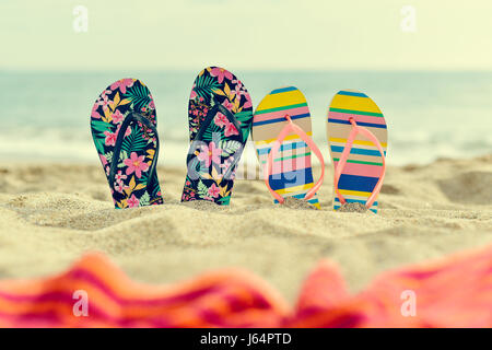 55d30c681 ... two different pair of colorful flip-flops