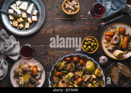 Ready-made kasul, cheese, bread, olives on the table free space - Stock Photo