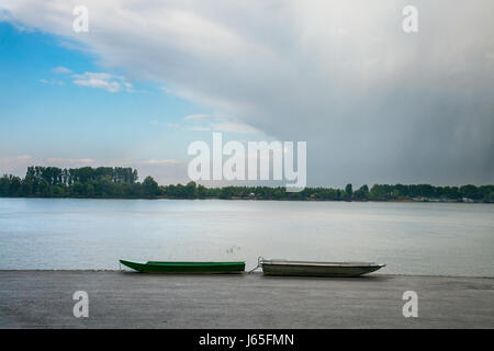 Two fishing boats on Zemun Quay (Zemunski kej) in a cloudy afternoon over the Danube river, Belgrade, capital city - Stock Photo