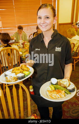Michigan Chesaning Showboat Restaurant family dining business table chairs diners woman waitress job plates dishes - Stock Photo