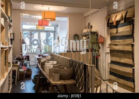 Interior of Birdie Fortesque's homeware shop - with straw baskets and rugs - Stock Photo