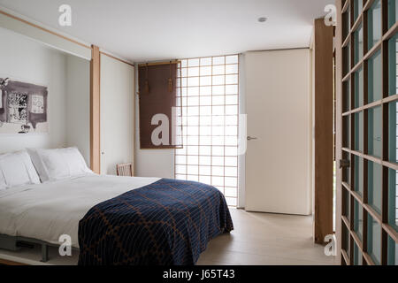 ... Zen Like Bedroom With White Laminate, Oak And Rattan Screens   Stock  Photo