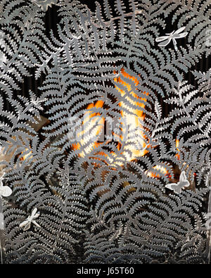 Fern and dragonfly metal fire-screen designed by Isabelle de Borchgrave - Stock Photo