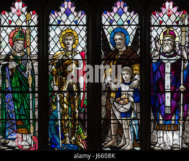The four British Patron Saints in the First World War Memorial window by Christopher Whall, St. Peter's Church, - Stock Photo