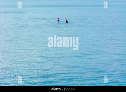 Two lonely rowers on the big water. - Stock Photo