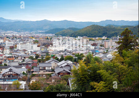 Cityscape of Shugakuin area in north Kyoto city seen from hilltop of Enkoji Temple, during autumn in Japan - Stock Photo