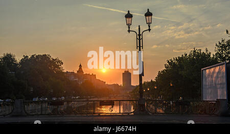 Sunrise in Bucharest city, the shore of Dambovita river, downtown - Stock Photo
