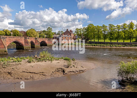 The bridge over the river Dee at Chester with Handbridge on the far bank. - Stock Photo