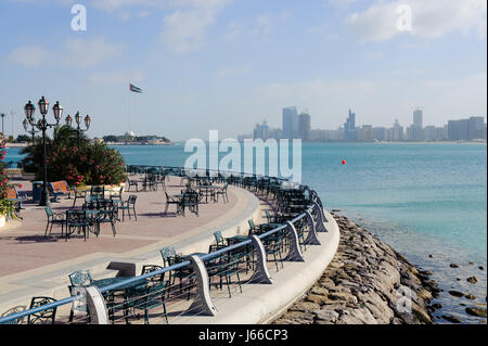 city town fence flag salt water sea ocean water cafe restaurant house - Stock Photo